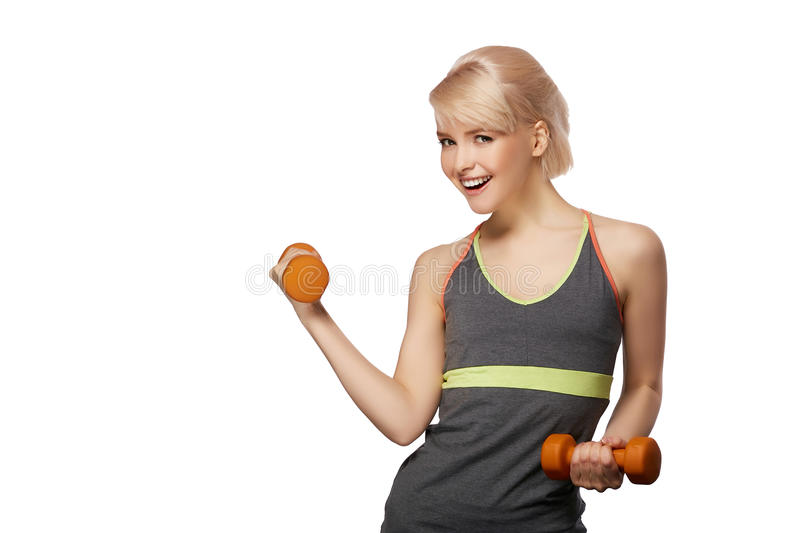 Woman with dumbbells. Happy smiling slim woman with dumbbells isolated on white background royalty free stock photography