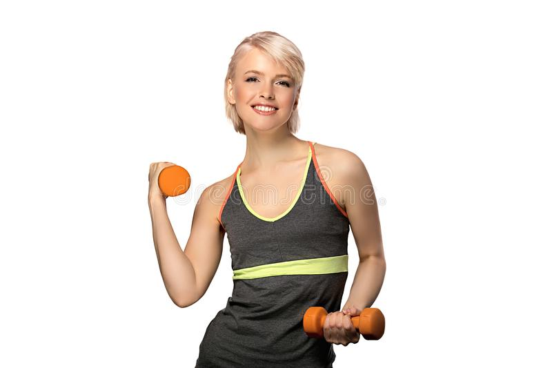 Woman with dumbbells. Happy smiling slim woman with dumbbells isolated on white background stock photos