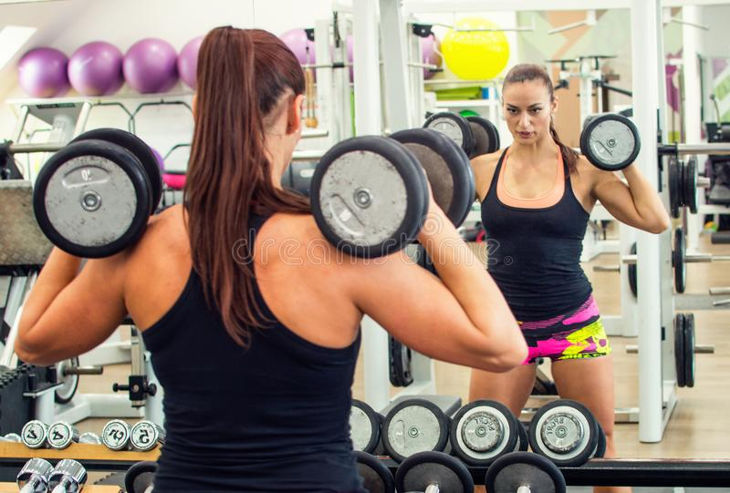 Woman with dumbbells. stock images