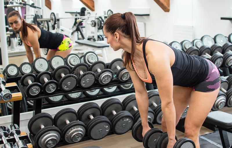 Woman with dumbbells. stock photography