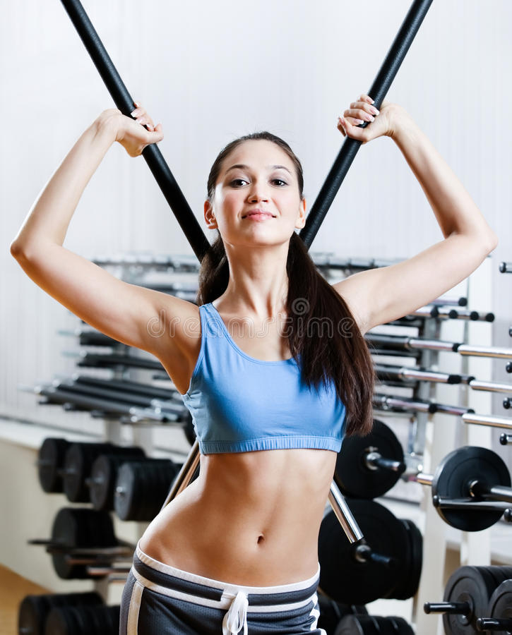 Download Woman With Dumbbells Stick Royalty Free Stock Images - Image: 28593089