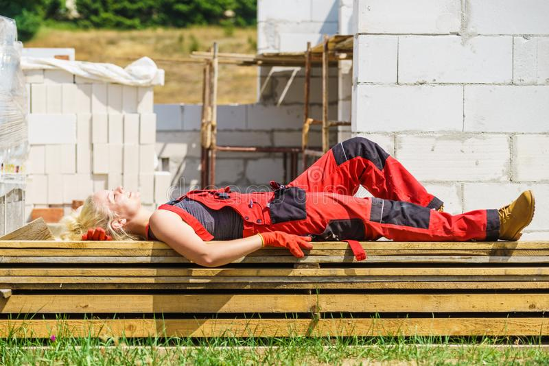 Woman taking break on construction site royalty free stock photography