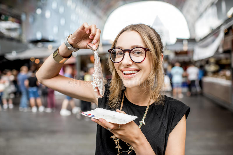 Woman with dutch herring royalty free stock image