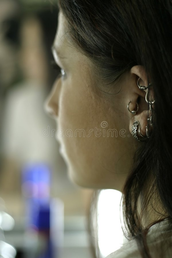 Download Woman with ear-rings stock photo. Image of beauty, young - 1291262