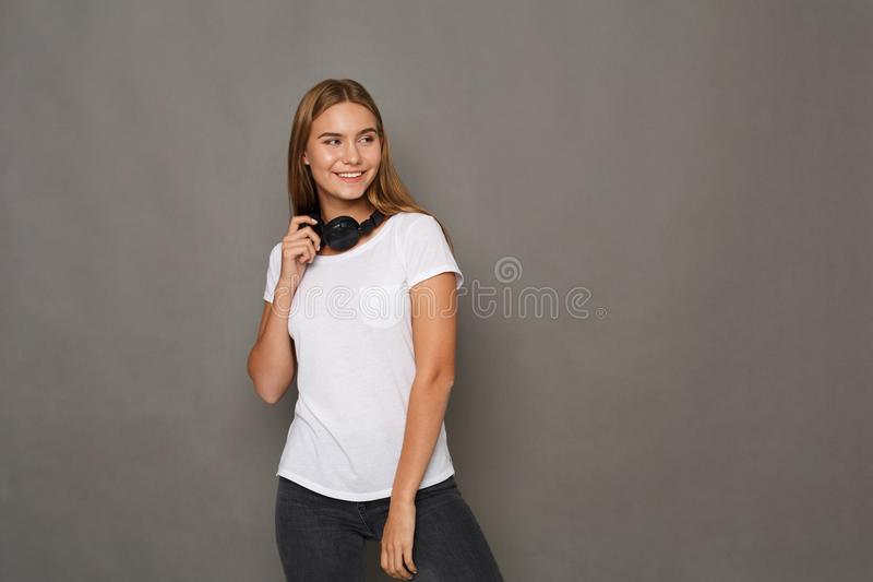 Woman with earphones, studio shot royalty free stock photography