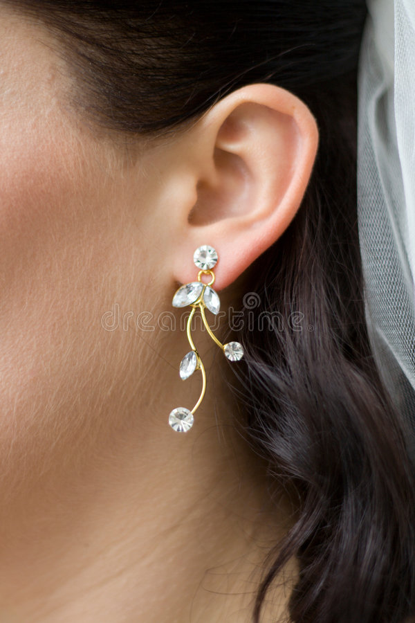 Woman earring bride royalty free stock photo