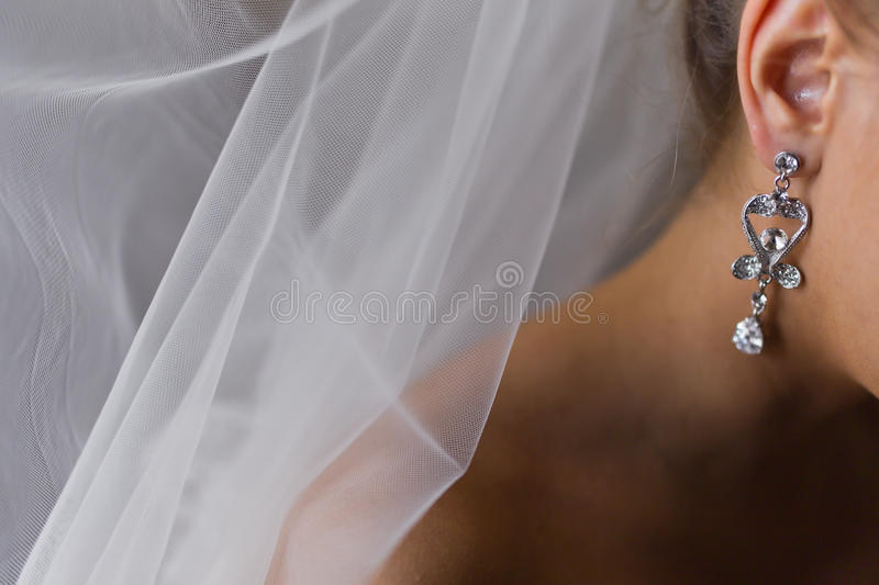 Woman earring bride royalty free stock images