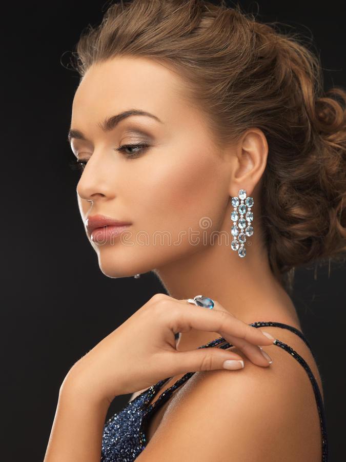 Woman with earrings and ring royalty free stock photo
