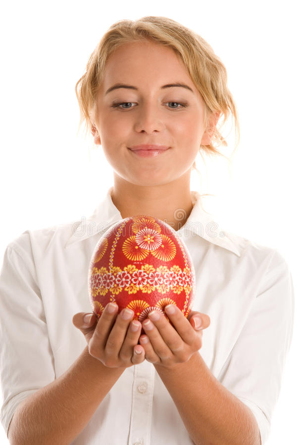 Woman with easter egg. Woman holding easter egg isolated on white background royalty free stock image