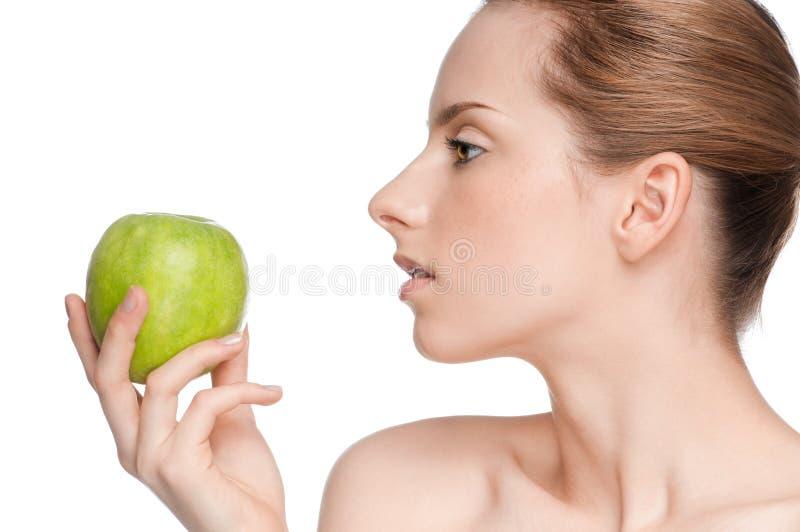 Download Woman eat green apple stock photo. Image of beautiful - 20453880