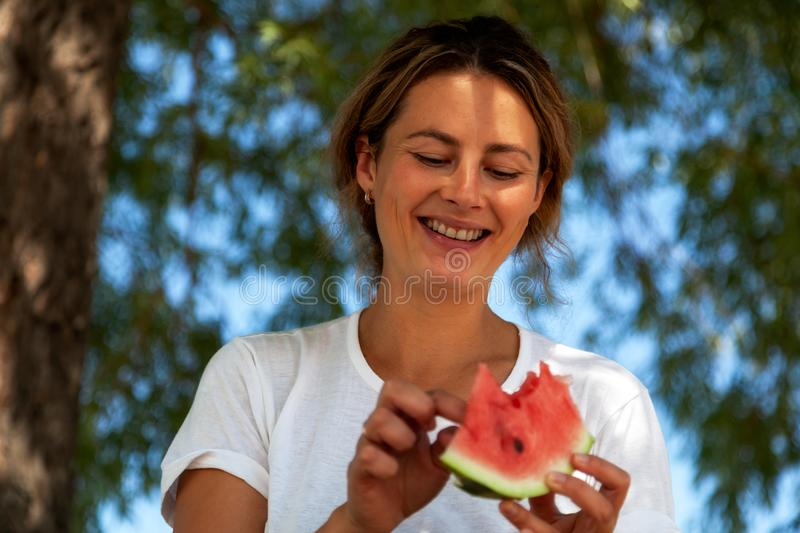 Woman eat watermelon royalty free stock images