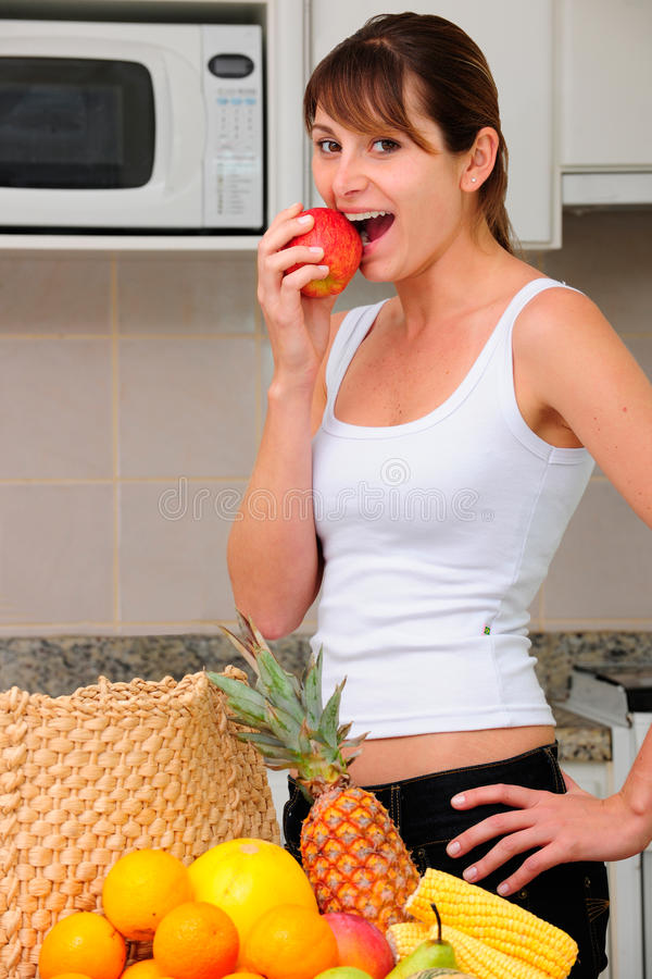 Woman eating an apple royalty free stock images