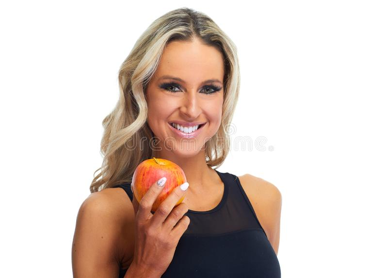Woman eating apple. Young beautiful sportive woman with apple isolated white background stock photos