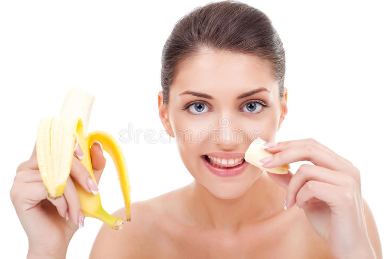 Woman eating banana and smiling stock photography