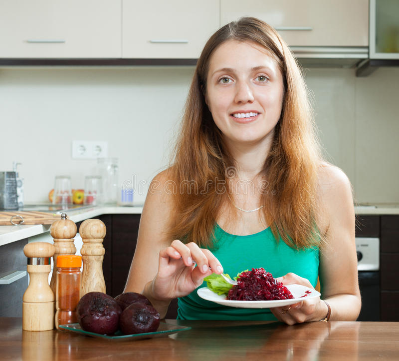 Woman eating boiled beets royalty free stock images