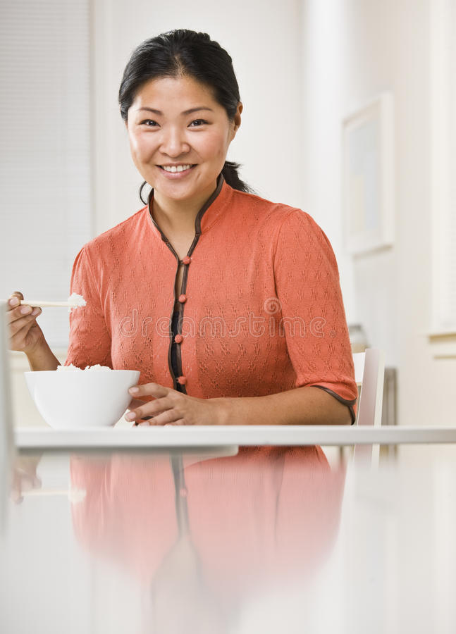 Woman Eating Bowl of Rice royalty free stock photography