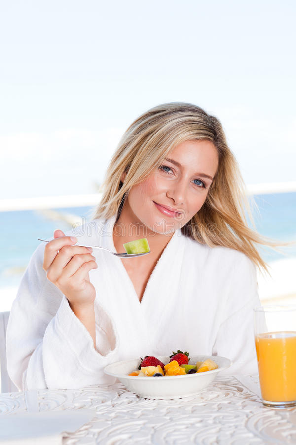 Woman Eating Breakfast Stock Image