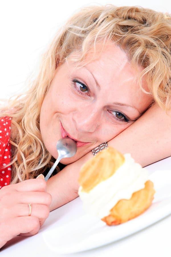 Woman eating cake royalty free stock photos