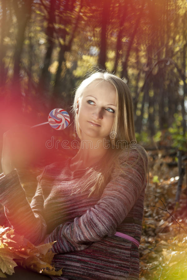 Woman Eating Candy Lollipops Royalty Free Stock Image
