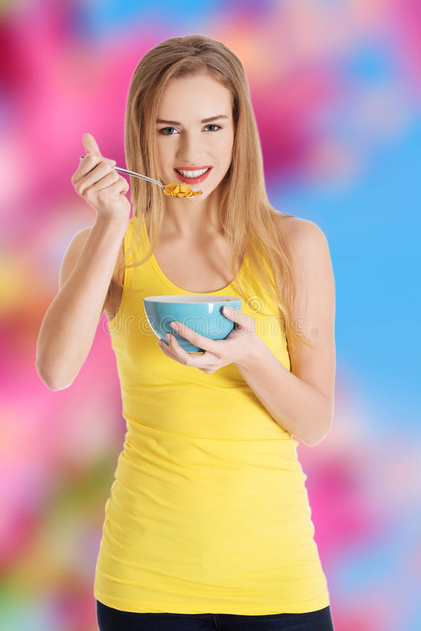 Woman eating cereal stock images