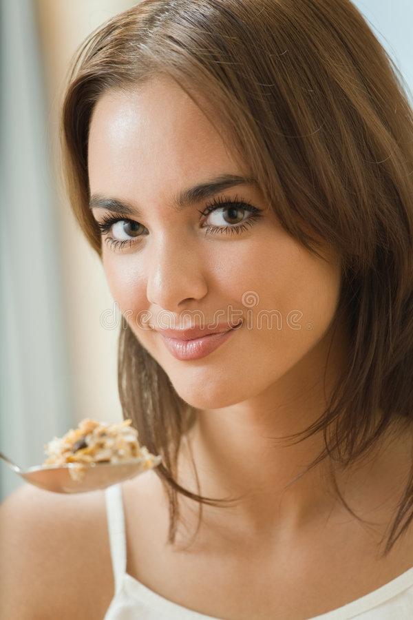 Woman eating cereal muslin royalty free stock photography