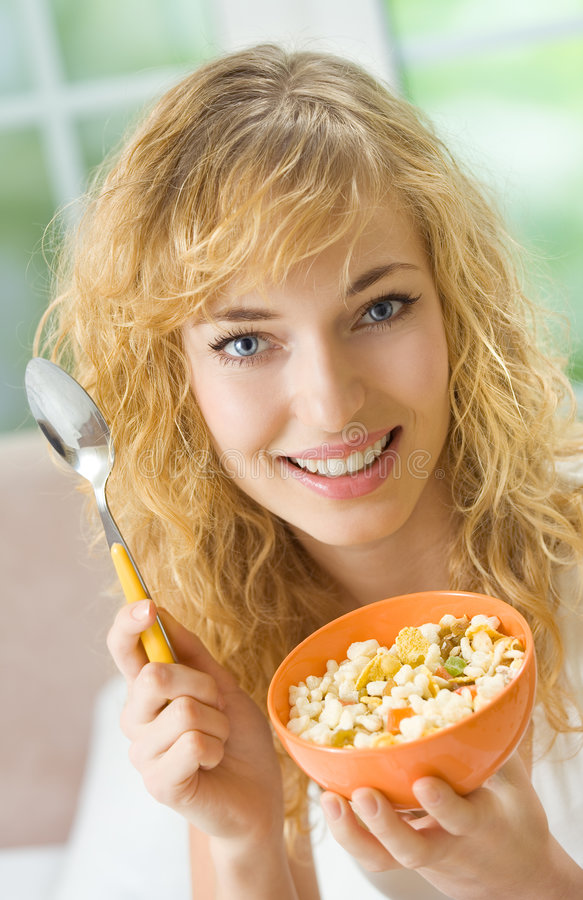 Woman eating cereal muslin royalty free stock images