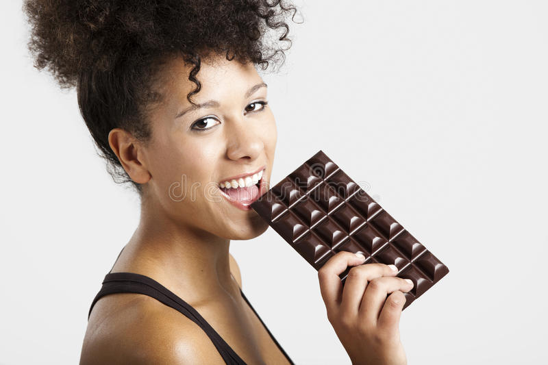 Woman eating chcolate royalty free stock photo