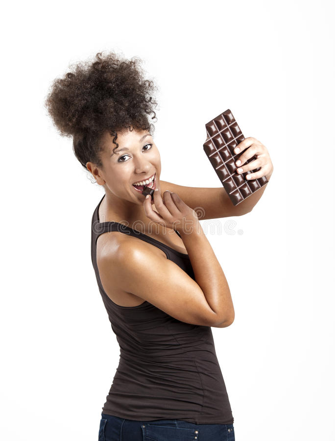 Woman eating chcolate stock images