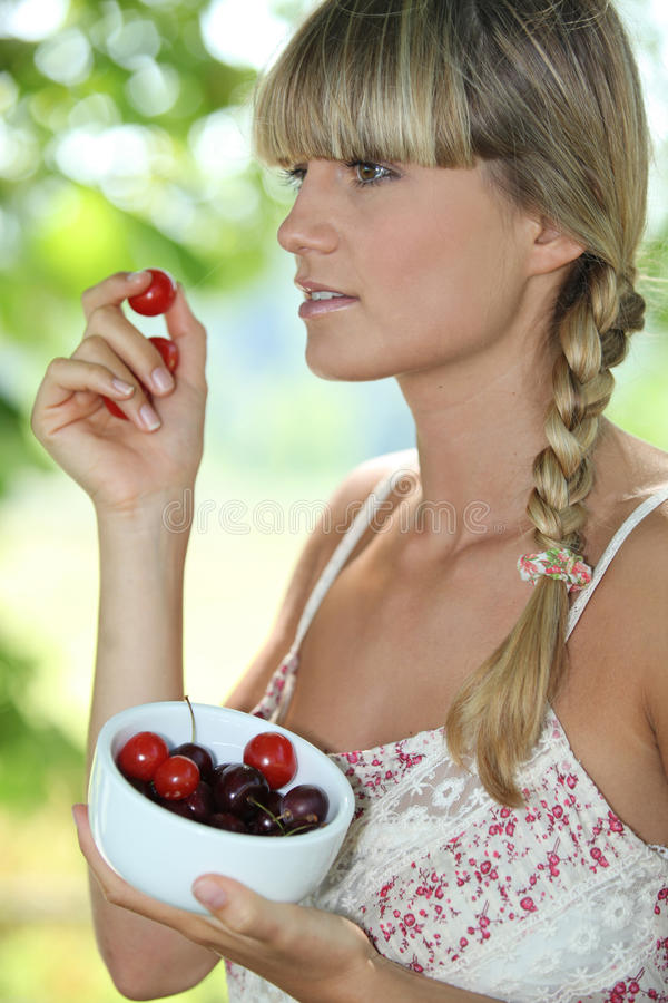 Download Woman eating cherries stock image. Image of blonde, person - 29064227