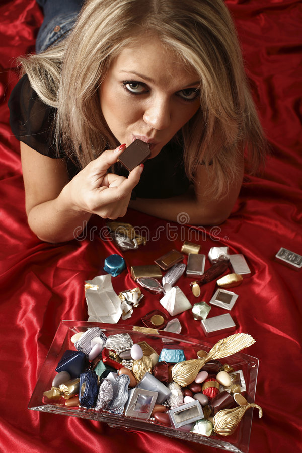 Download Woman eating chocolate stock photo. Image of girl, cocoa - 9187356