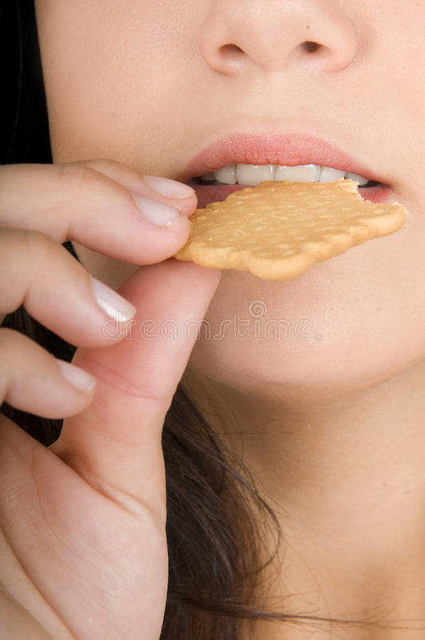 Woman Eating Cookies Stock Images