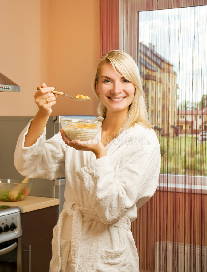 Woman eating cornflakes royalty free stock photography