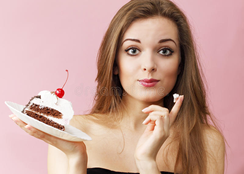 Woman eating cream finger royalty free stock images