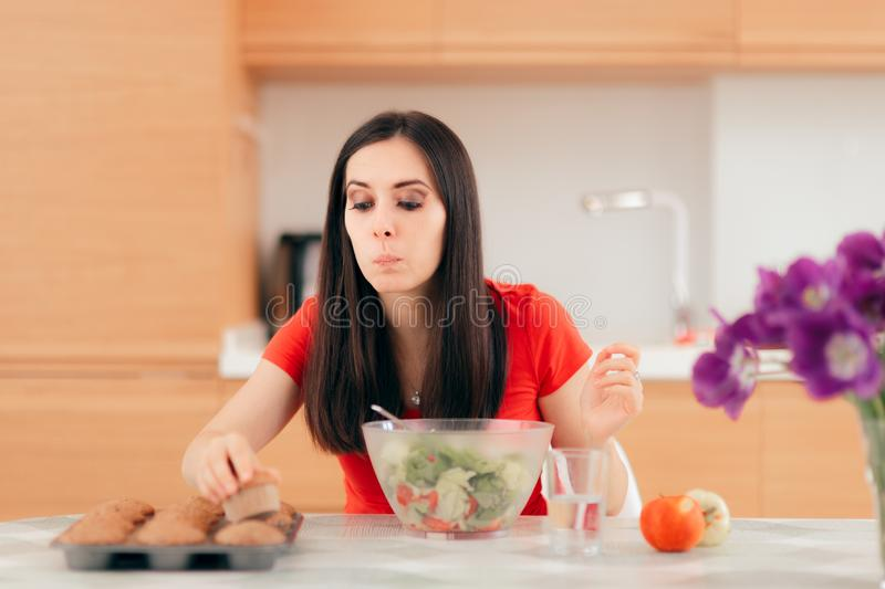 Woman Eating a Cupcake instead of Apples or Salad stock photography