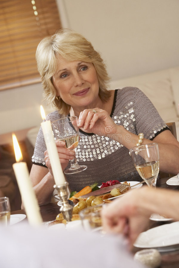Woman Eating Dinner At Home stock photos