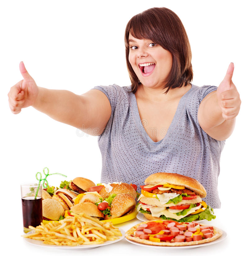 Woman eating fast food. Overweight woman eating fast food royalty free stock photography