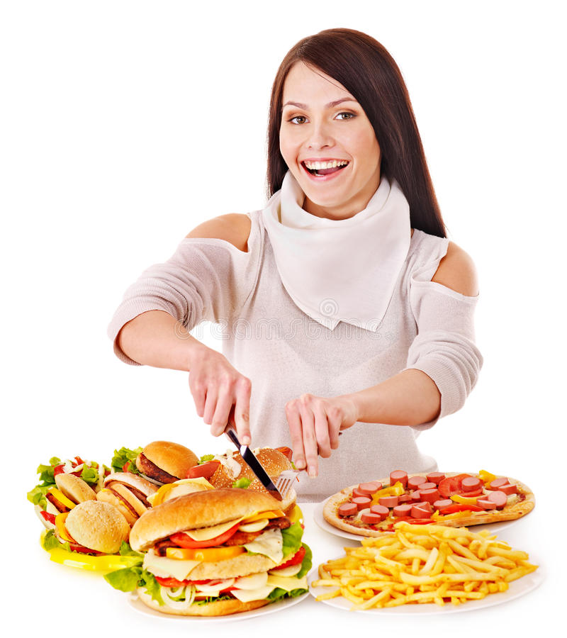 Woman eating fast food. Isolated royalty free stock images