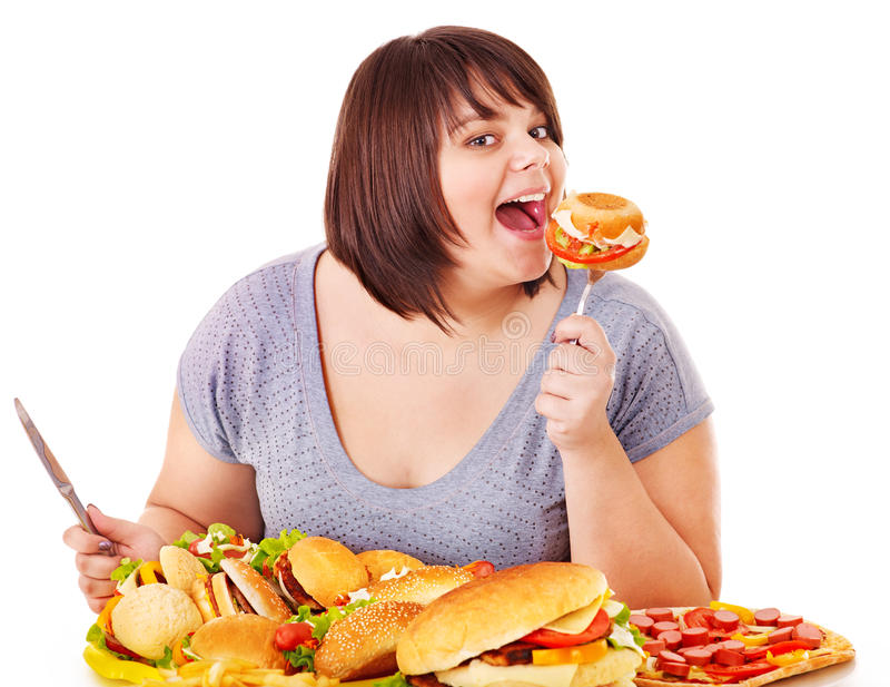 Woman eating fast food. Isolated stock photos