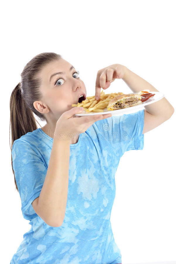 Woman eating fast food. Young woman eating fast food stock photos