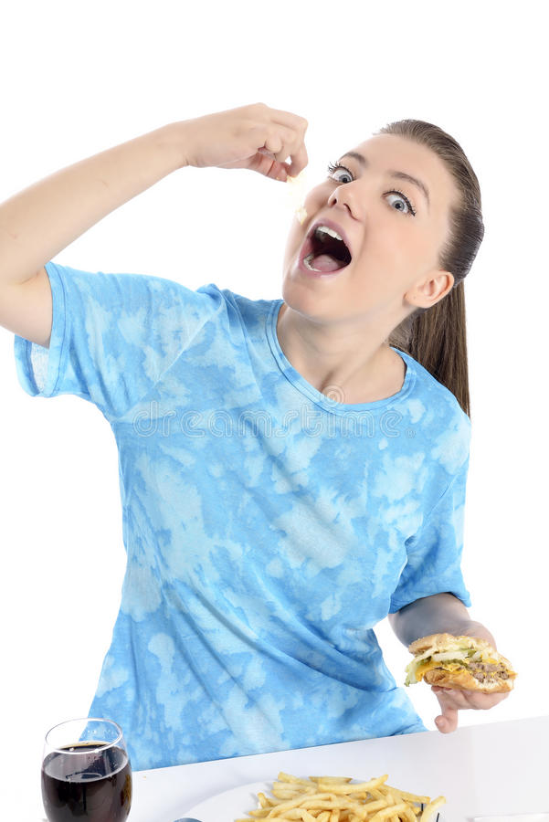 Woman eating fast food. Young woman eating fast food. beautiful girl hungry royalty free stock photos