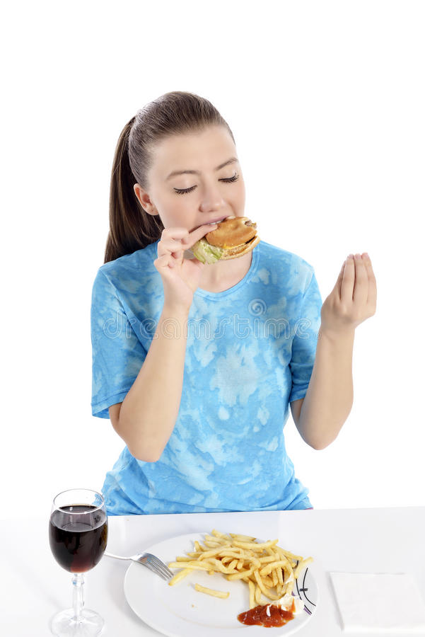 Woman eating fast food. Young woman eating fast food. beautiful girl hungry. woman eyes closed stock photo