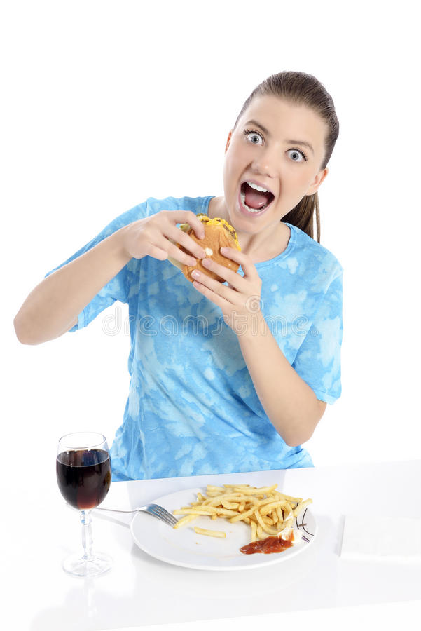 Woman eating fast food. Young woman eating fast food. beautiful girl very hungry royalty free stock photography