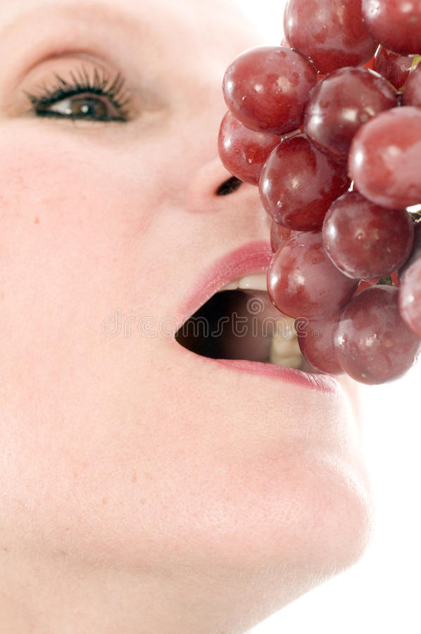 Download Woman Eating Fresh Red Grapes Stock Photo - Image: 11141210