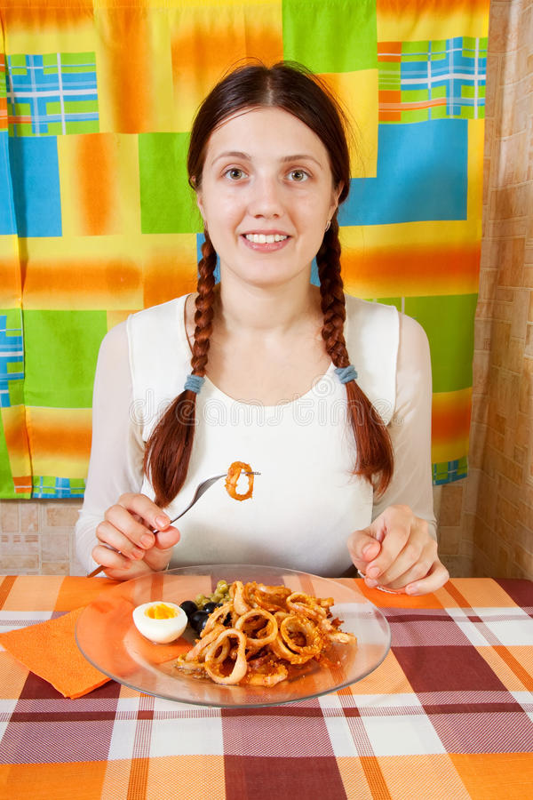 Woman Eating  Fried Calamaries Rings Royalty Free Stock Images
