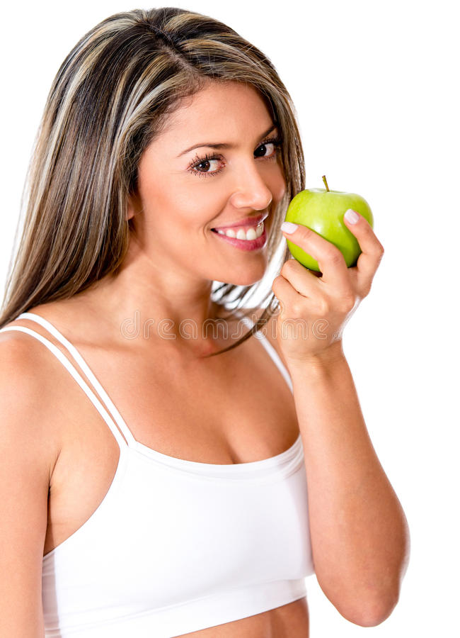 Woman eating a fruit