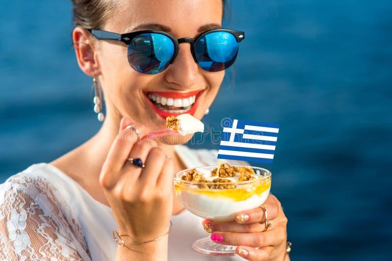 Woman eating greek yogurt royalty free stock image