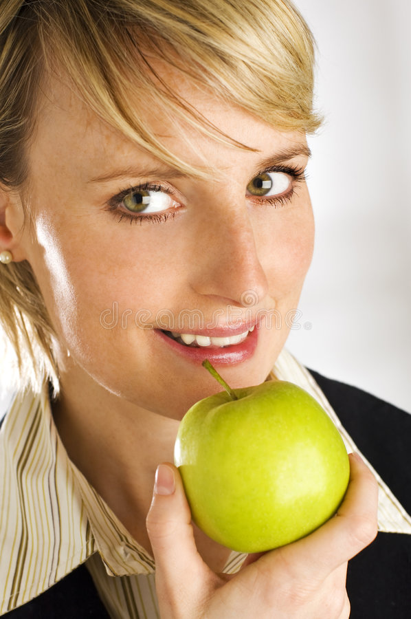 Download Woman Eating Green Apple stock photo. Image of blond, woman - 5366648