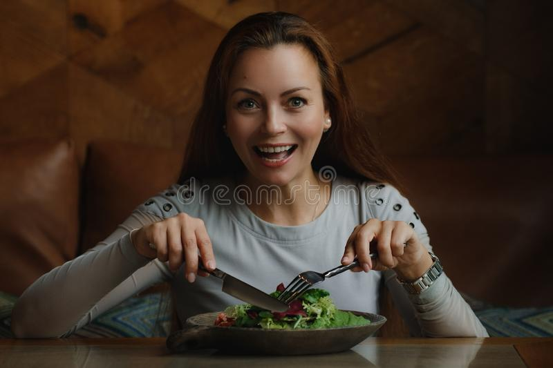 Woman eating green tasty stock images