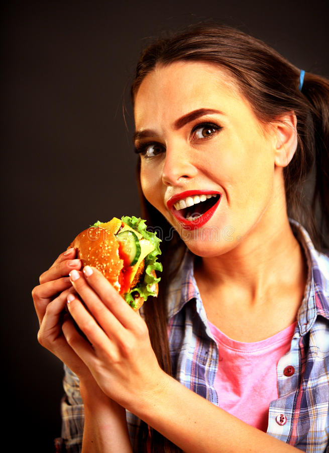 Woman eating hamburger. Girl wants to eat burger. stock photography