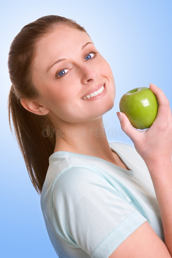 Woman Eating Healthy. Beautiful isolated woman eating healthy royalty free stock image